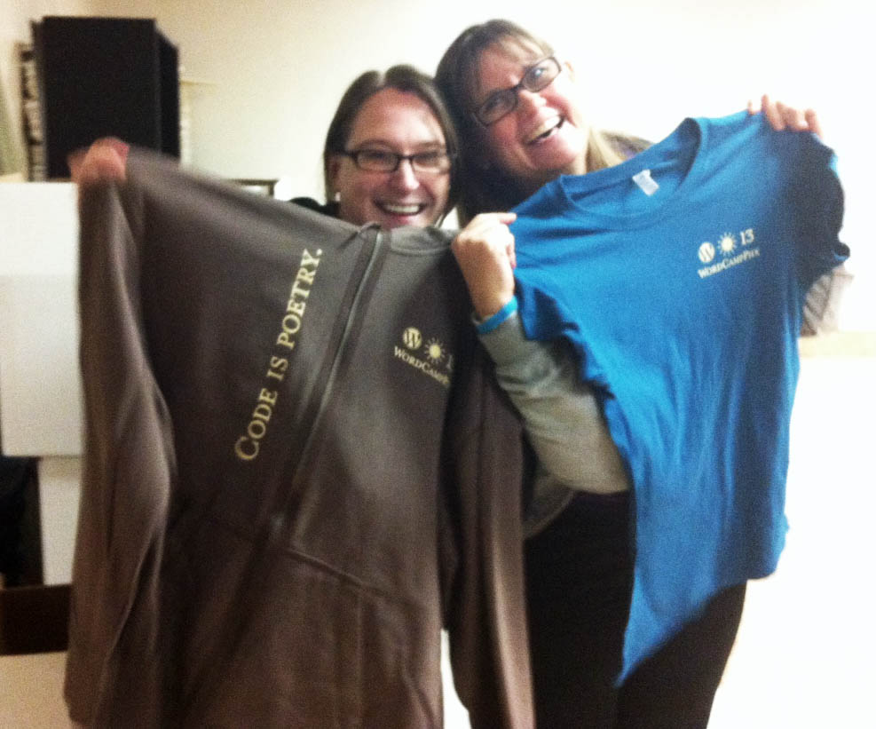 April Holle and Carol Stambaugh with a hoodie and a shirt.